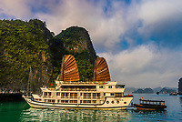 Aclass Cruises Stellar anchored in Halong Bay, North Vietnam. The bay features 3,000  limestone and dolomite karsts and islets in various shapes and sizes sprinkled over 1,500 square kilometers. It offers a wonderland of karst topography. It is a UNESCO World Heritage Site.