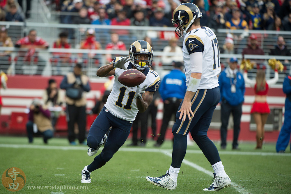 January 3, 2016; Santa Clara, CA, USA; St. Louis Rams wide receiver Tavon Austin (11) receives the hand off from quarterback Case Keenum (17) during the second quarter against the San Francisco 49ers at Levi's Stadium. The 49ers defeated the Rams 19-16.
