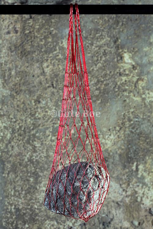 heavy stone in a net type bag