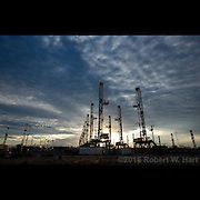 Inactive drilling rigs sit in an Odessa, Texas oil field service yard on November 29, 2015. Odessa sits squarely in the Permian Basin where, despite being an oil-rich region, drilling has decreased by 60 percent in 2015.