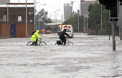 File photo dated 25/06/07 of people cycling through water on Cleveland Street in Hull, after heavy rainfall caused flooding. The 2007 floods which brought devastation to Sheffield and Hull and left three people dead are being remembered 10 years after the deluge.