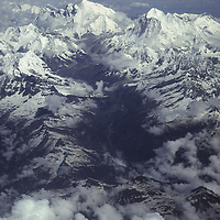 NEPAL, Himalaya Aerial view of Mts. Everest (center) & Makalu (R) amidst building monsoon clouds.