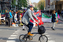 The protests have created a traffic-free area for commuting cyclists as hundreds of environmental protesters from Extinction Rebellion occupy Marble Arch, camping in the square and even on the streets, blocking access to traffic on Park Lane and Oxford Street in London's usually traffic-heavy west end. . London, April 16 2019.