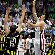 Efes Pilsen's Igor RAKOCEVIC (R) during their Turkish Basketball league Play Off Final fifth leg match Efes Pilsen between Fenerbahce Ulker at the Ayhan Sahenk Arena in Istanbul Turkey on Sunday 30 May 2010. Photo by Aykut AKICI/TURKPIX
