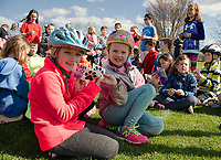 """Lilly and Taylor from Pleaseant Street School show off their """"safe kids"""" and """"PSS Pride"""" stickers following their bike ride on the WOW Trail Monday afternoon.  (Karen Bobotas/for the Laconia Daily Sun)"""