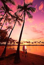 Mother and child walking, `Anaeho`omalu Beach at sunset, Waikoloa, Big Island, Hawaii, Pacific Ocean