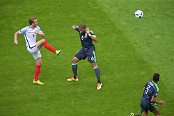 LENS, FRANCE - Thursday, June 16, 2016: England's Harry Kane in action against Wales' captain Ashley Williams during the UEFA Euro 2016 Championship Group B match at the Stade Bollaert-Delelis. (Pic by Paul Greenwood/Propaganda)