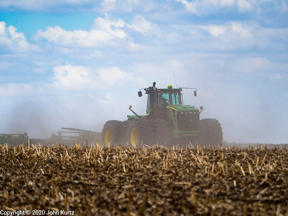 """20 APRIL 2020 - BOUTON, IOWA: A farmer tills a field near Bouton. Iowa farmers are prepping their fields for the 2020 season. The relatively mild winter and dry spring has allowed farmers to get into their fields 1 - 2 weeks earlier than last year. Farmers and agricultural workers are considered """"essential"""" workers in Iowa and not subjected to the coronavirus restrictions nonessential workers are. Farmers usually work by themselves, and social distancing guidelines have not impacted them as much as it has workers in Iowa's cities.      PHOTO BY JACK KURTZ"""