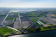 Nederland, Noord-Holland, Medemblik, 07-05-2018; Wieringermeerpolder met gemaal De Lely, een van de twee gemalen verantwoordelijk voor het droogmalen van de Wieringermeer; architect Dirk Roosenburg. Kassen Agriport A7 in de achtergrond.<br /> Wieringermeer polder with pumping station De Lely, one of the two pumping stations responsible for the draining of the Wieringermeer.<br /> <br /> <br /> luchtfoto (toeslag op standard tarieven);<br /> aerial photo (additional fee required);<br /> copyright foto/photo Siebe Swart
