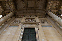 Ornate Paris Door at Pantheon - Thousands of doors and gates adorn buildings in Paris.  Some of the best are on government offices, cathedrals and churches, as well as a few chateau.  However, any self-respecting contractor with a decent budget probably spent a lot of consideration in installing suitable doors, windows, grill work and even doorknobs. Some of these gates, doors and windows are very simple, while others are extravagant works of art. The styles of these doors tell about the history of France. As you walk across the 20 arrondissements of Paris, you will discover Gothic, Renaissance, Haussmann and Art Nouveau door styles. It is up to you to take the time to look for little details of these Paris' most beautiful doors with statues, bas-reliefs, mascarons, gold-leaf, grills, handles and door knobs.