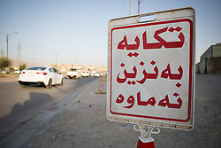 © Licensed to London News Pictures. 26/06/2014. Sulaimaniyah, Iraq. A sign apologising to drivers for a lack of petrol (literal translation: Excuse me the petrol is finished) is seen blocking the entrance to a fuel station in Sulaimaniyah, Iraqi-Kurdistan. Despite being an oil-rich country Iraq's main oil refinery at Baiji is now the hands of ISIS insurgents cutting much of the fuel to the rest of the country. Petrol rationing has come in to force across northern Iraq with huge queues that mean many drivers wait in line for hours, sometimes overnight, just to receive their allowance of 30 litres. The shortage has also seen a huge increase in fuel prices with a litre of petrol rising 150% from 500 Iraqi Dinars to 1500 Iraqi Dinars. Photo credit: Matt Cetti-Roberts/LNP