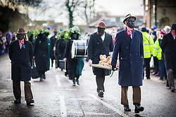 DATE CORRECTION. IMAGES SHOT 14/01/2017 © Licensed to London News Pictures. 14/01/2017. Whittlesey UK. Picture shows members of the Old Glory Molly dancers at the 38th Whittlesey Straw Bear Festival this weekend. In times past when starvation bit deep the ploughmen of the area where drawn to towns like Whittlesey, They knocked on doors begging for food & disguised their shame by blackening their faces with soot. In Whittlesey it was the custom on the Tuesday following Plough Monday to dress one of the confraternity of the plough in straw and call him a Straw Bear. The bear was then taken around town to entertain the folk who on the previous day had subscribed to the rustics, a spread of beer, tobacco & beef. The bear was made to dance in front of houses & gifts of money, beer & food was expected. Photo credit: Andrew McCaren/LNP