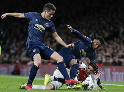 BRITAIN-LONDON-FOOTBALL-FA CUP-ARSENAL VS MAN UNITED.(190125) -- LONDON, Jan. 25, 2019  Arsenal's Lucas Torreira (Below) vies with Manchester United's Jesse Lingard (C) during the FA Cup fourth round match between Arsenal and Manchester United at the Emirates Stadium in London, Britain on Jan. 25, 2019. Manchester United won 3-1.  FOR EDITORIAL USE ONLY. NOT FOR SALE FOR MARKETING OR ADVERTISING CAMPAIGNS. NO USE WITH UNAUTHORIZED AUDIO, VIDEO, DATA, FIXTURE LISTS, CLUBLEAGUE LOGOS OR ''LIVE'' SERVICES. ONLINE IN-MATCH USE LIMITED TO 45 IMAGES, NO VIDEO EMULATION. NO USE IN BETTING, GAMES OR SINGLE CLUBLEAGUEPLAYER PUBLICATIONS. (Credit Image: © Xinhua via ZUMA Wire)
