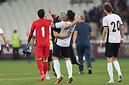 Geraldo Alves of Astra Giurgiu lifts Marius Sumudica, manager of Astra Giurgiu after full time as they celebrate their win. UEFA Europa league, 1st play off round match, 2nd leg, West Ham Utd v Astra Giurgiu at the London Stadium, Queen Elizabeth Olympic Park in London on Thursday 25th August 2016.<br /> pic by John Patrick Fletcher, Andrew Orchard sports photography.