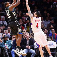 16 December 2015: Milwaukee Bucks guard Khris Middleton (22) takes a jump shot over Los Angeles Clippers guard J.J. Redick (4) during the Los Angeles Clippers 103-90 victory over the Milwaukee Bucks, at the Staples Center, Los Angeles, California, USA.