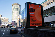 With local coronavirus lockdown measures in place and Birmingham currently set at 'Tier 2', Public Health England / NHS digital information poster advising that the local lockdown level is 'High' in the city centre on 26th October 2020 in Birmingham, United Kingdom. The three tier system in the UK has levels: 'medium', which includes the rule of six, 'high', which will cover most areas under current restrictions; and 'very high' for those areas with particularly high case numbers. Meanwhile there have been calls by politicians for a 'circuit breaker' complete lockdown to be announced to help the growing spread of the Covid-19 virus.