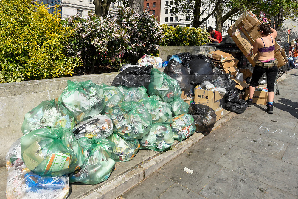 """© Licensed to London News Pictures. 22/04/2019. LONDON, UK. Piles of rubbish awaiting collection next to activists gathered at Marble Arch during """"London: International Rebellion"""", on day eight of a protest organised by Extinction Rebellion.  Protesters are demanding that governments take action against climate change.  After police issued section 14 orders at the other protest sites of Oxford Circus, Waterloo Bridge and Parliament Square resulting in over 900 arrests, protesters have convened at the designated site of Marble Arch so that the protest can continue.  Photo credit: Stephen Chung/LNP"""