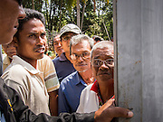 08 FEBRUARY 2014 - PHAWONG, SONGKHLA, THAILAND: Men wait to get into the bullring in rural Songkhla, Thailand. Bullfighting is a popular past time in southern Thailand. Hat Yai is the center of Thailand's bullfighting culture. In Thai bullfights, two bulls are placed in an arena and they fight, usually by head butting each other, until one runs away or time is called. Huge amounts of mony are wagered on Thai bullfights - sometimes as much as 2,000,000 Thai Baht ($65,000 US).   PHOTO BY JACK KURTZ