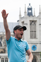 London, UK. 9th June, 2018. A supporter of Tommy Robinson, former leader of the far-right English Defence League, makes a Nazi salute in front of anti-fascists protesting against the far-right March for Tommy Robinson in Parliament Street.