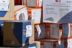20.03.2020, Wien, AUT, Coronaviruskrise, Österreich, Übergabe von 3000 Schutzanzügen und 150.000 Schutzmasken an den Arbeiter Samariterbund (ASBÖ), im Bild Kartons mit Schutzmasken und Schutzanzüge // Handover of 3000 protective suits and 150,000 protective masks to the Austrian Samaritan Federation (ASBÖ). The Austrian government is pursuing aggressive measures in an effort to slow the ongoing spread of the coronavirus. Wien, Austria on 2020/03/20. EXPA Pictures © 2020, PhotoCredit: EXPA/ Herbert Neubauer/APA-POOL