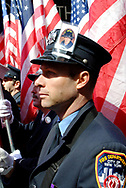 Manhattan, NY, USA. March 17, 2009. FDNY firefighter LUKE ALLEN, Marching in St. Patrick's Day Parade, displays on his hat a photo of his older brother firefighter RICHARD D. ALLEN, one of 343 FDNY firefighters killed responding to terrorist attacks on Twin Towers Sept. 11, 2001.