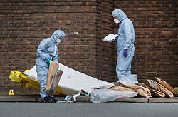 © Licensed to London News Pictures. 03/04/2018. London, UK. Police gather evidence in bags (R) outside Walthamstow Leisure Centre after a youngster was shot and another was stabbed. A few miles away in Tottenham police are investigating after a 17 year old girl was shot and killed late last night. Photo credit: Peter Macdiarmid/LNP