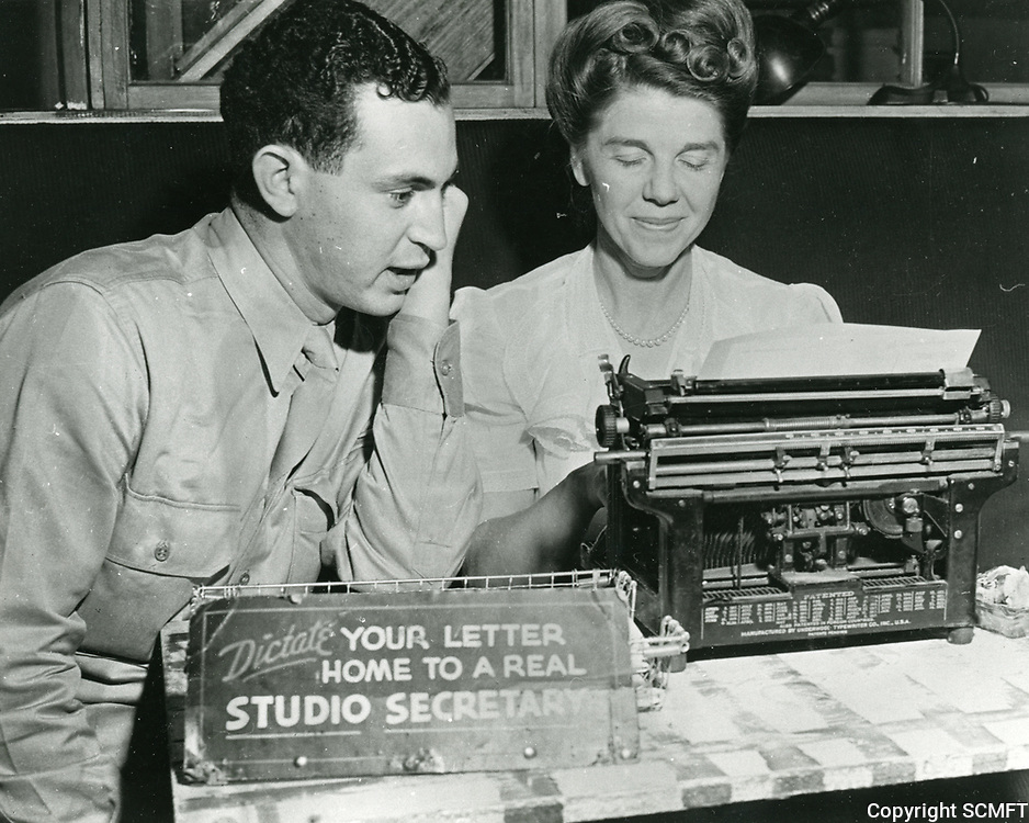 1943 A serviceman dictates a letter to a movie studio secretary at the Hollywood Canteen. Hundreds of such letters were typed and sent to servicemen's families.