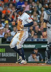 April 30, 2018 - Houston, TX, U.S. - HOUSTON, TX - APRIL 30:  Houston Astros right fielder George Springer (4) scores a run during the baseball game between the New York Yankees and Houston Astros on April 30, 2018 at Minute Maid Park in Houston, Texas.  (Photo by Leslie Plaza Johnson/Icon Sportswire) (Credit Image: © Leslie Plaza Johnson/Icon SMI via ZUMA Press)