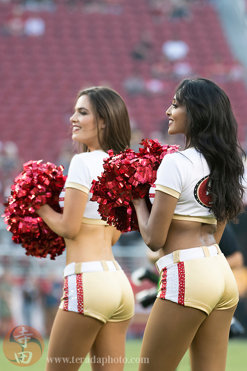August 31, 2017; Santa Clara, CA, USA; San Francisco 49ers Gold Rush cheerleaders Sierrah (left) and Anisha (right) before the game against the Los Angeles Chargers at Levi's Stadium. The 49ers defeated the Chargers 23-13.