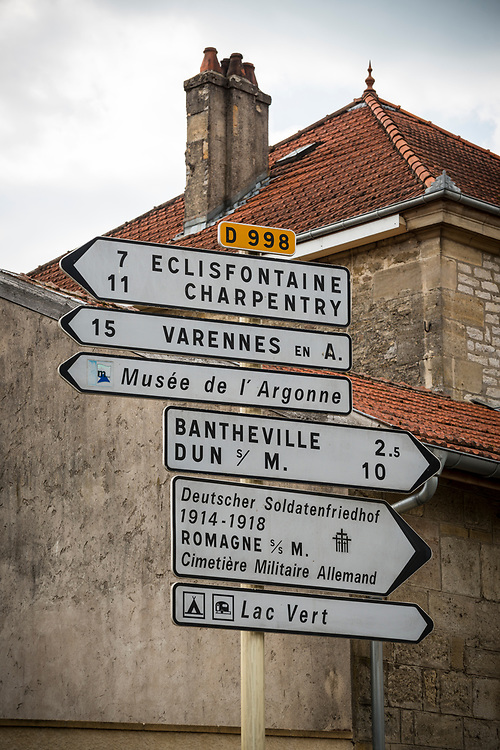 Directional road sign in the small town of Romagne-sous-Montfaucon, 42 kilometers northwest of Verdun, France. The area was the scene of much fighting during World War I. The town is home 14,246 American graves at the Meuse-Argonne American Cemetery and Memorial.