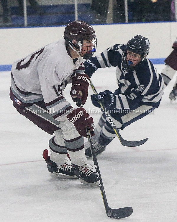 (1/26/19, DEDHAM, MA) Dedham's Andrwew Mercuri  takes the puck up the ice during the boys hockey game against Medway at Nobles in Dedham on Saturday. [Daily News and Wicked Local Photo/Dan Holmes]