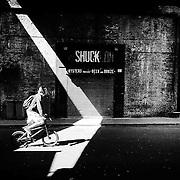 Morning light streaks through a railway bridge to create an unusual effect across the old Shuck Ldn bar in Borough Market. Shot on iPhone 6.