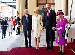 (left to right) the Duke of Edinburgh, Queen Letizia of Spain, King Felipe VI and Queen Elizabeth II, pose for the media at the steps of the Grand Hall entrance at Buckingham Palace, London, during the King's State Visit to the UK. Picture dated: Wednesday July 12, 2017. Photo credit should read: Isabel Infantes / EMPICS Entertainment.