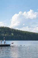 Teenagers swimming in Lake McDonald Glacier National Park