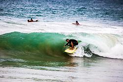 Surfer in curl at Kealia Beach on the island of Kauai in Hawaii