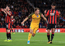 Brighton & Hove Albion's Solly March (centre) celebrates scoring his side's first goal of the game during the Premier League match at the Vitality Stadium, Bournemouth.