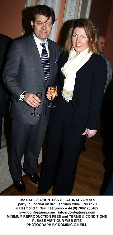 The EARL & COUNTESS OF CARNARVON at a party in London on 3rd February 2004.PRG 178