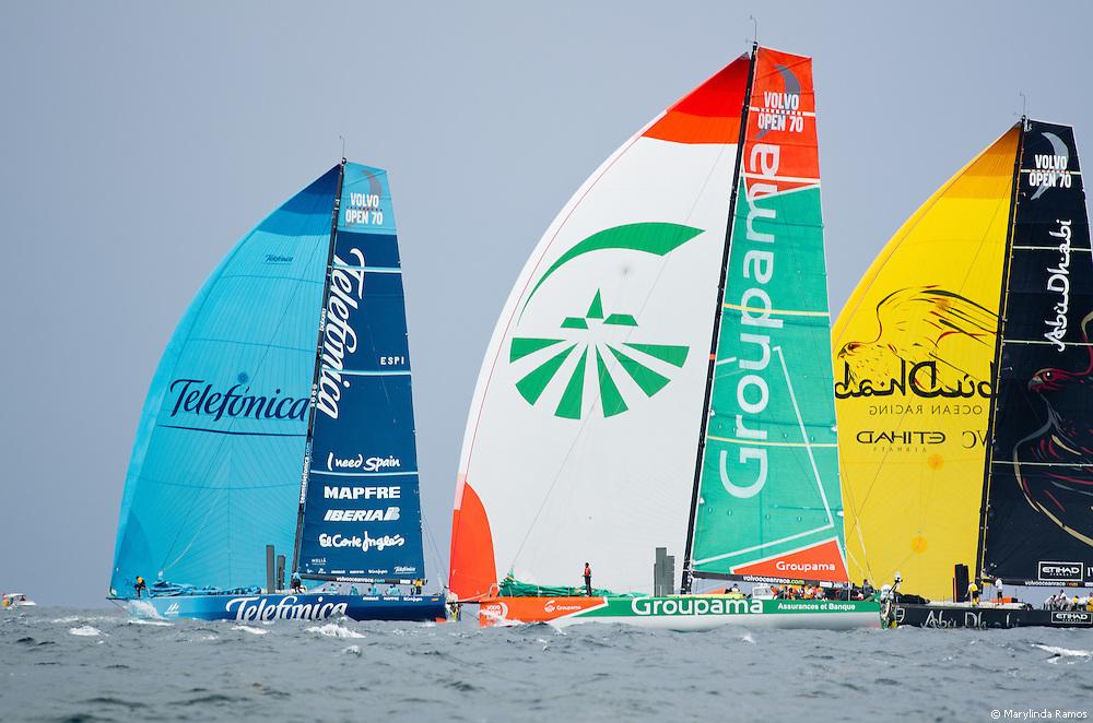 Telefonica, Groupama, and Abu Dhabi Ocean Racing under spinnaker at the 2011-2012 Volvo Ocean Race Miami in-port race.