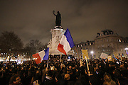 """French flags flying. A massive public demonstration took place in Place de la Republique, in central Paris, France; the evening after armed gunmen attacked the offices of Charlie Hebdo, killing twelve people, including the editor and celebrated cartoonists; four more are in critical condition. It is the dealiest terror attack in France for over fifty years. Charlie Hebdo is a satirical publication well known for its political cartoons. <br /><br />As a solidarity actions with the deaths at Charlie Hebdo many placards read """"Je suis Charlie"""" translating as """"I am Charlie (Hebdo)"""". Demonstrators held aloft pens, brushes and crayons, symbolizing the profession of journalists and cartoonists who were killed. Many pens were placed in a shrine with candles in the square"""