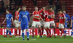 Matt Godden of Peterborough United cuts a dejected figure as Middlesbrough celebrate scoring a goal - Mandatory by-line: Joe Dent/JMP - 05/01/2019 - FOOTBALL - Riverside Stadium - Middlesbrough, England - Middlesbrough v Peterborough United - Emirates FA Cup third round proper
