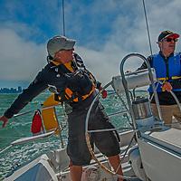Sailors navigate through wind-chopped water in San Francisco Bay, California.