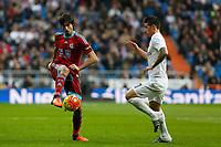 Real Madrid´s James Rodriguez (R) and Real Sociedad´s Carlos Martinez Diez during La Liga match between Real Madrid and Real Sociedad at Santiago Bernabeu stadium in Madrid, Spain. December 30, 2015. (ALTERPHOTOS/Victor Blanco)