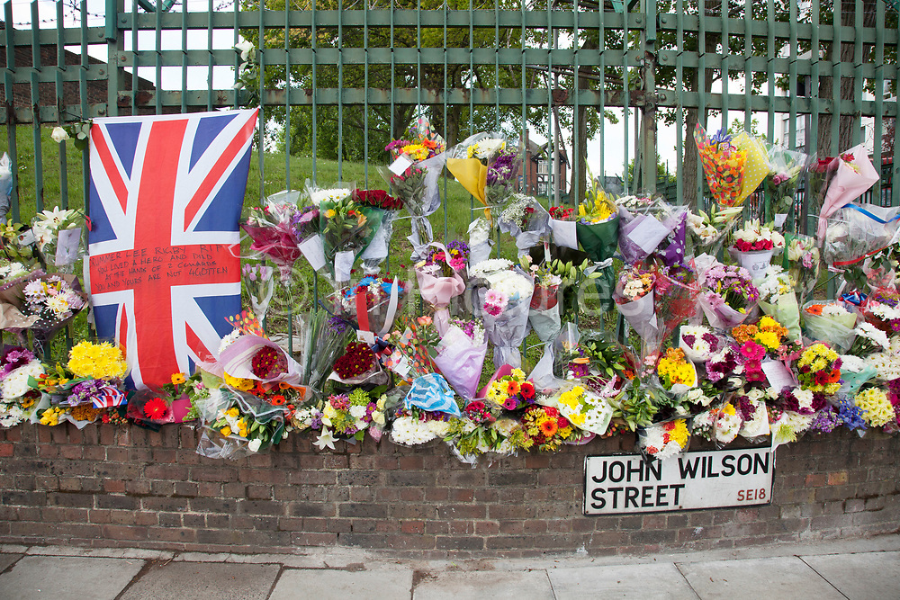 London, UK. Saturday 25th May 2013. Memorial to Drummer Lee Rigby in Woolwich, London, UK. Flowers from every section of the local community along with messages of condolence and support. On the afternoon of 22 May 2013, Lee Rigby, a British Army soldier and a Drummer of the Royal Regiment of Fusiliers, was killed by two attackers near the Royal Artillery Barracks in Woolwich, south-east London.