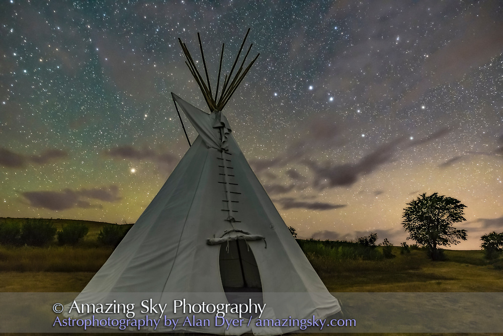 The Big Dipper and Arcturus (at left) over a single tipi at the Two Trees site at Grasslands National Park, Saskatchewan, August 6, 2018. <br /> <br /> This is a stack of 10 exposures, mean combined to smooth noise, for the ground, and one untracked exposure for the sky, all 30 seconds at f/2.8 with the 20mm Sigma lens and Nikon D750 at ISO 6400. <br /> <br /> Light cloud passing through added the natural star glows, enlarging the stars and making the pattern stand out. No soft focus filter was employed, and illumination is from starlight. No light painting was employed. Some airglow and aurora colour the sky.<br /> <br /> A Glow filter from ON1 Photo Raw applied to the sky to further soften the sky.