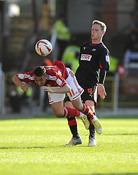Swindon Town's Gary Roberts is fouled by Brentford's Adam Forshaw - Photo mandatory by-line: Joe Meredith/JMP - Tel: Mobile: 07966 386802 04/05/2013 - SPORT - FOOTBALL - County Ground - Swindon - Swindon Town v Brentford - Npower League one Play Off