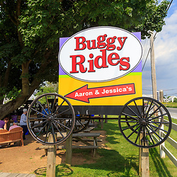 Bird-in-Hand, PA - June 1, 2016: A large sign at Horse-drawn buggy rides attraction which is popular with tourists visiting Lancaster County, PA.