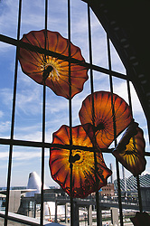 United States, Washington, Tacoma, Glass art by Dale Chihuly in window of Union Station, with Museum of Glass in distance.