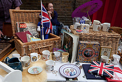 © Licensed to London News Pictures. 04/06/2012. London, England. .A trader selling vintage Royal memorabilia at A traditional East End street party celebrating the Diamond Jubilee in the Spitalfields area of London..The Royal Jubilee celebrations. Great Britain is celebrating the 60th  anniversary of the countries Monarch HRH Queen Elizabeth II accession to the throne this weekend Photo credit : RICH BOWEN/LNP