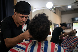 Kelvin Guzman works at his barber shop in Guaimaca, Honduras. Kelvin migrated to the US but was deported. He has been helped to set up a small business by the Lutheran World Federation with support from ELCA.