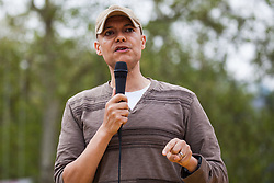 London, UK. 23rd April 2019. Clive Lewis MP, Shadow Minister for Sustainable Economics, addresses climate change activists from Extinction Rebellion at an assembly in Parliament Square prior to an attempt to deliver to Parliament activists' letters requesting meetings to discuss climate change with their Members of Parliament.